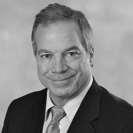 Dr. John Giella